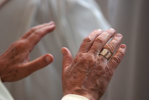 Hands of a Catholic priest, praying