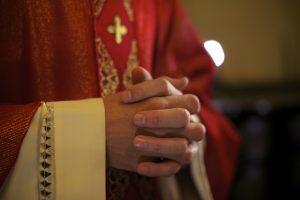 Catholic priest on altar